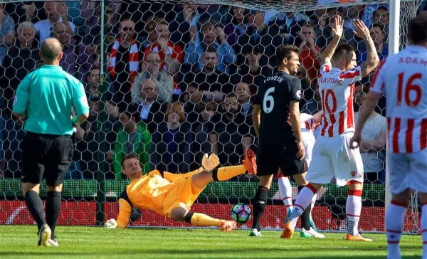 STOKE-ON-TRENT, ENGLAND - Saturday, April 8, 2017: Liverpool's goalkeeper Simon Mignolet is beaten as Stoke City score the opening goal during the FA Premier League match at the Bet365 Stadium. (Pic by David Rawcliffe/Propaganda)