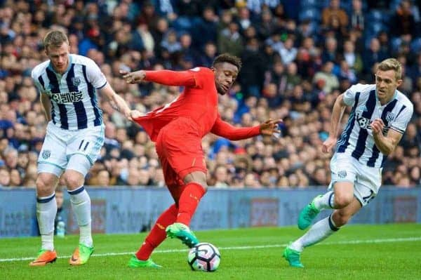 WEST BROMWICH, ENGLAND - Easter Sunday, April 16, 2017, 2016: Liverpool's Divock Origi has his shirt pulled by West Bromwich Albion's Chris Brunt during the FA Premier League match at the Hawthorns. (Pic by David Rawcliffe/Propaganda)