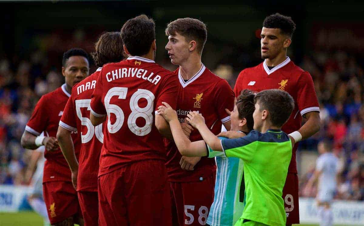 BIRKENHEAD, ENGLAND - Wednesday, July 12, 2017: Young supporters run on to celebrate Liverpool's third goal against Tranmere Rovers during a preseason friendly match at Prenton Park. (Pic by David Rawcliffe/Propaganda)