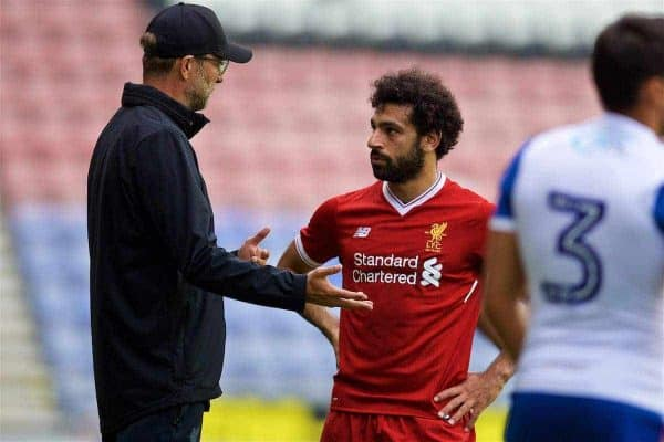 Liverpool's manager Jürgen Klopp and Mohamed Salah during a preseason friendly match against Wigan Athletic at the DW Stadium. (Pic by David Rawcliffe/Propaganda)