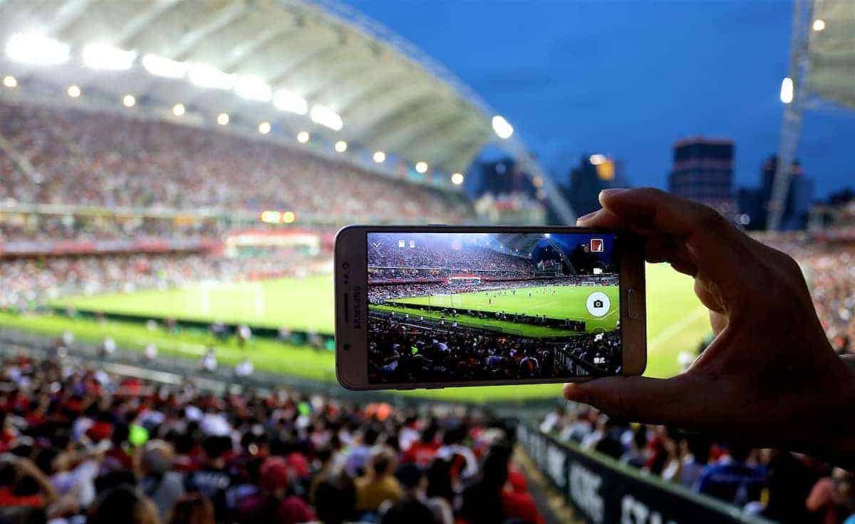 HONG KONG, CHINA - Wednesday, July 19, 2017: A supporter takes a photo on an iPhone during the Premier League Asia Trophy match between Leicester City and West Bromwich Albion at the Hong Kong International Stadium. (Pic by David Rawcliffe/Propaganda)