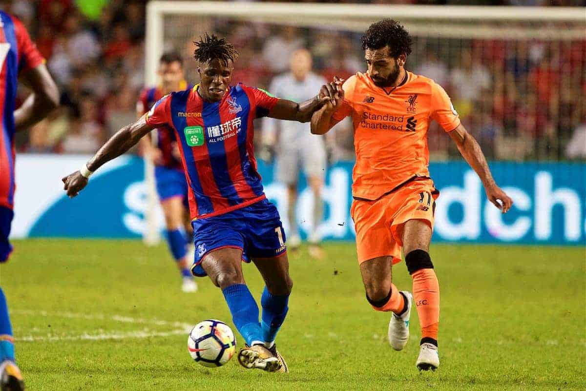 HONG KONG, CHINA - Wednesday, July 19, 2017: Liverpool's Mohamed Salah and Crystal Palace's Wilfried Zaha during the Premier League Asia Trophy match between Liverpool and Crystal Palace at the Hong Kong International Stadium. (Pic by David Rawcliffe/Propaganda)