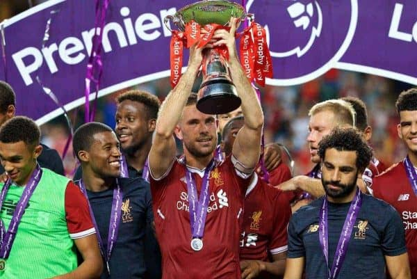 Liverpool's captain Jordan Henderson lifts the trophy after beating Leicester City 2-1 during the Premier League Asia Trophy final match between Liverpool and Leicester City at the Hong Kong International Stadium. (Pic by David Rawcliffe/Propaganda)