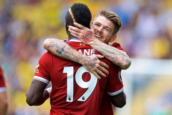 WATFORD, ENGLAND - Saturday, August 12, 2017: Liverpool's Sadio Mane celebrates scoring the first equalising goal with team-mate Alberto Moreno during the FA Premier League match between Watford and Liverpool at Vicarage Road. (Pic by David Rawcliffe/Propaganda)
