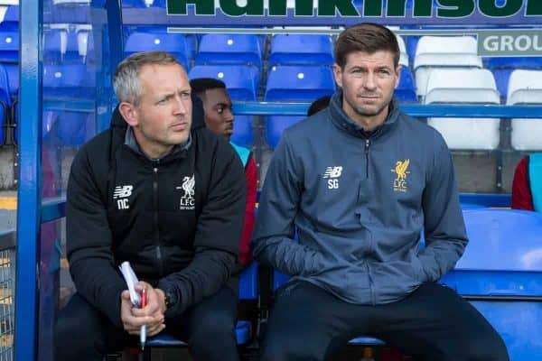 BIRKENHEAD, ENGLAND - Wednesday, September 13, 2017: Liverpool Under 18's manager Steven Gerrard sits on the bench alongside Under 23's coach Neil Critchley ahead of the UEFA Youth League Group E match between Liverpool and Sevilla at Prenton Park. (Pic by Paul Greenwood/Propaganda)