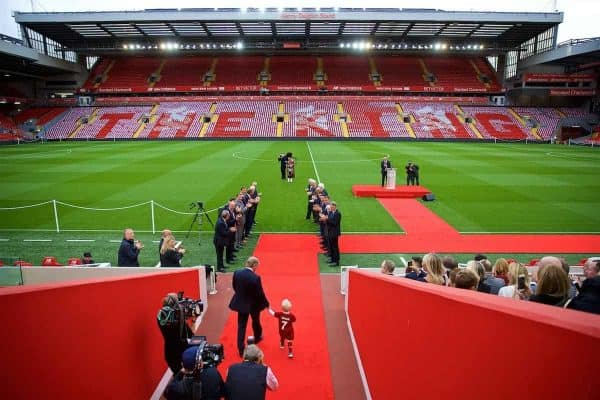 LIVERPOOL, ENGLAND - Friday, October 13, 2017: Kenny Dalglish walks out of the Anfield tunnel with his grandson for at a ceremony to rename Liverpool FC's Centenary Stand the Kenny Dalglish Stand. (Pic by David Rawcliffe/Propaganda)
