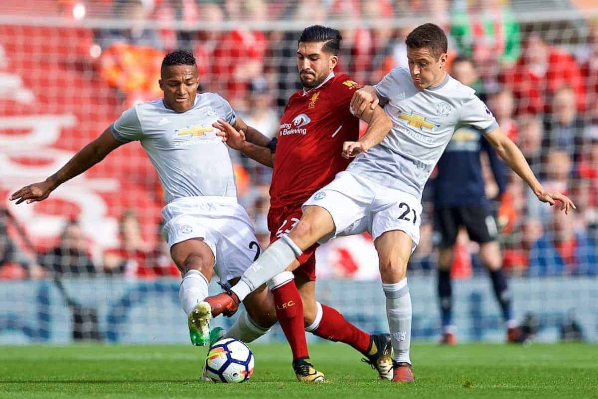 LIVERPOOL, ENGLAND - Saturday, October 14, 2017: Liverpool's Emre Can is tackled by Manchester United's Antonio Valencia and Ander Herrera during the FA Premier League match between Liverpool and Manchester United at Anfield. (Pic by David Rawcliffe/Propaganda)