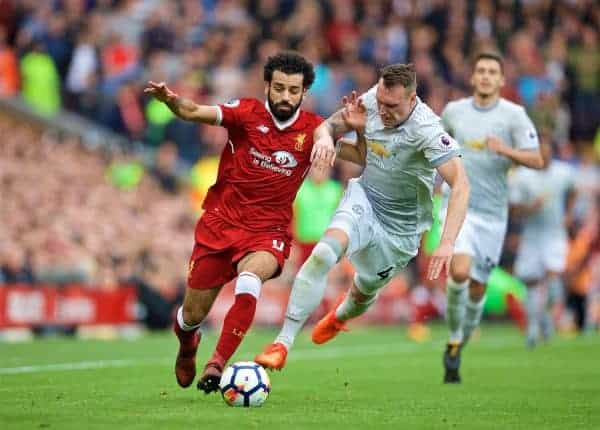 Liverpool's Mohamed Salah and Manchester United's Phil Jones during the FA Premier League match between Liverpool and Manchester United at Anfield. (Pic by David Rawcliffe/Propaganda)