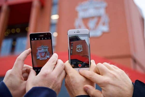 LIVERPOOL, ENGLAND - Saturday, October 28, 2017: Supporter take photographs of a Liverpool crest on the side of the Main Stand during the FA Premier League match between Liverpool and Huddersfield Town at Anfield. (Pic by David Rawcliffe/Propaganda)