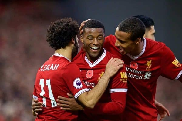 LIVERPOOL, ENGLAND - Saturday, October 28, 2017: Liverpool's Georginio Wijnaldum celebrates scoring the third goal with team-mate Mohamed Salah [L] and Joel Matip [R] during the FA Premier League match between Liverpool and Huddersfield Town at Anfield. (Pic by David Rawcliffe/Propaganda)