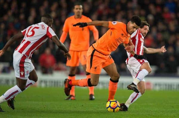 Liverpool's Dominic Solanke in acton with Stoke City's Bruno Martins Indi and Joe Allen during the FA Premier League match between Stoke City and Liverpool at the Bet365 Stadium. (Pic by Peter Powell/Propaganda)