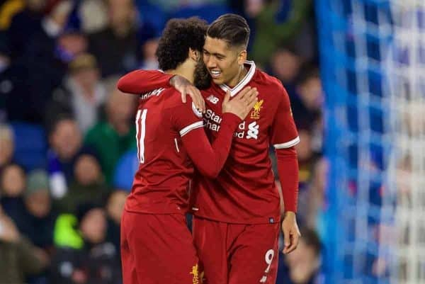 Liverpool's Roberto Firmino celebrates scoring the third goal with team-mate Mohamed Salah during the FA Premier League match between Brighton & Hove Albion FC and Liverpool FC at the American Express Community Stadium. (Pic by David Rawcliffe/Propaganda)