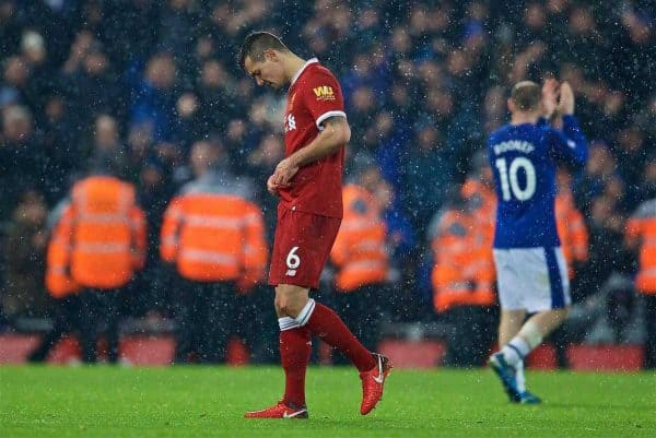 LIVERPOOL, ENGLAND - Sunday, December 10, 2017: Liverpool's Dejan Lovren walks off dejected after his push handed Everton a penalty from which they scored an undeserved equalising goal, scored by Wayne Rooney, during the FA Premier League match between Liverpool and Everton, the 229th Merseyside Derby, at Anfield. (Pic by David Rawcliffe/Propaganda)