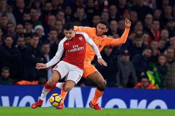 LONDON, ENGLAND - Friday, December 22, 2017: Liverpool's Joe Gomez and Arsenal's Alexis Sanchez during the FA Premier League match between Arsenal and Liverpool at the Emirates Stadium. (Pic by David Rawcliffe/Propaganda)