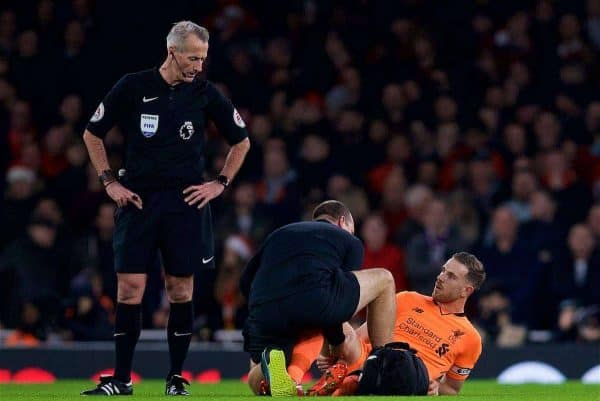 Liverpool's captain Jordan Henderson receives treatment for an injury during the FA Premier League match between Arsenal and Liverpool at the Emirates Stadium. (Pic by David Rawcliffe/Propaganda)