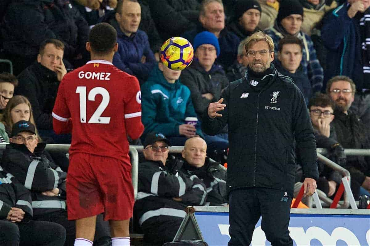 SWANSEA, WALES - Monday, January 22, 2018: Liverpool's manager Jürgen Klopp throws the ball to Joe Gomez during the FA Premier League match between Swansea City FC and Liverpool FC at the Liberty Stadium. (Pic by David Rawcliffe/Propaganda)