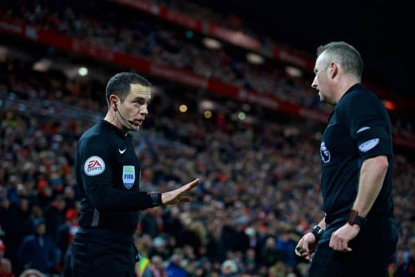 LIVERPOOL, ENGLAND - Sunday, February 4, 2018: Assistant referee Eddie Smart tries to impose a penalty for Tottenham Hotspur onto referee Jonathan Moss during the FA Premier League match between Liverpool FC and Tottenham Hotspur FC at Anfield. (Pic by David Rawcliffe/Propaganda)