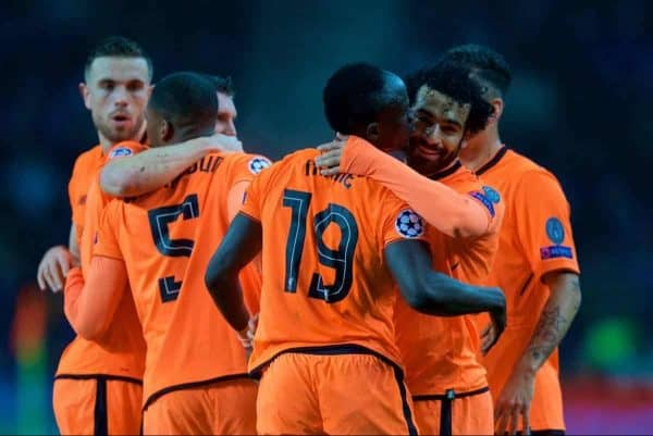 """Liverpool's Mohamed Salah celebrates scoring the second goal with team-mates during the UEFA Champions League Round of 16 1st leg match between FC Porto and Liverpool FC on Valentine's Day at the Est·dio do Drag""""o. (Pic by David Rawcliffe/Propaganda)"""
