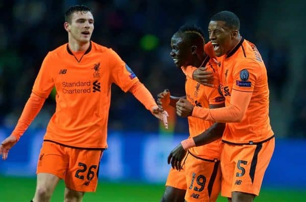 """PORTO, PORTUGAL - Wednesday, February 14, 2018: Liverpool's Sadio Mane celebrates scoring the first goal with team-mates Andy Robertson and Georginio Wijnaldum during the UEFA Champions League Round of 16 1st leg match between FC Porto and Liverpool FC on Valentine's Day at the Est·dio do Drag""""o. (Pic by David Rawcliffe/Propaganda)"""