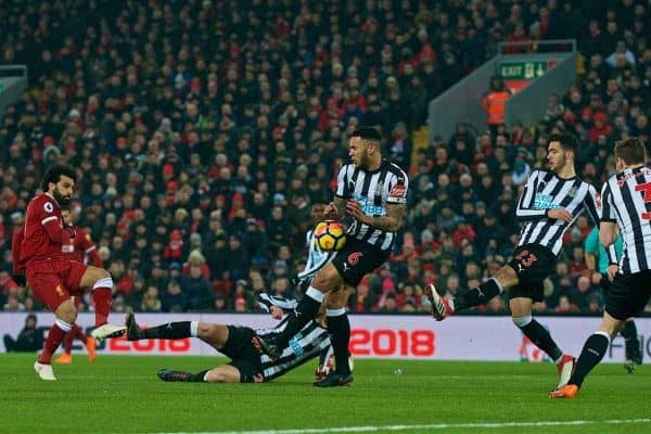 LIVERPOOL, ENGLAND - Saturday, March 3, 2018: Liverpool's Mohamed Salah sees his shot blocked by the arm of Newcastle United's captain Jamaal Lascelles during the FA Premier League match between Liverpool FC and Newcastle United FC at Anfield. (Pic by Peter Powell/Propaganda)