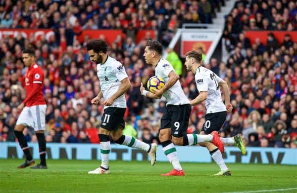 MANCHESTER, ENGLAND - Saturday, March 10, 2018: Liverpool's Roberto Firmino retrieves the ball as his side score their first goal to make it 2-1 during the FA Premier League match between Manchester United FC and Liverpool FC at Old Trafford. (Pic by David Rawcliffe/Propaganda)