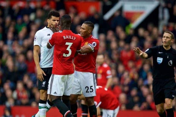MANCHESTER, ENGLAND - Saturday, March 10, 2018: Liverpool's Dominic Solanke is assaulted by Manchester United's Eric Bailly during the FA Premier League match between Manchester United FC and Liverpool FC at Old Trafford. (Pic by David Rawcliffe/Propaganda)