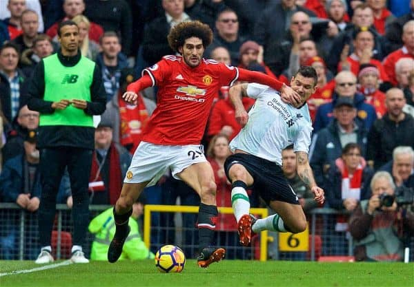 MANCHESTER, ENGLAND - Saturday, March 10, 2018: Manchester United's Marouane Fellaini and Liverpool's Dejan Lovren during the FA Premier League match between Manchester United FC and Liverpool FC at Old Trafford. (Pic by David Rawcliffe/Propaganda)