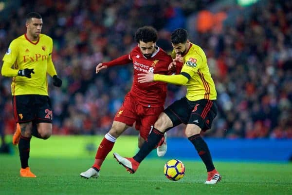 LIVERPOOL, ENGLAND - Saturday, March 17, 2018: Liverpool's Mohamed Salah and Watford's Miguel Britos during the FA Premier League match between Liverpool FC and Watford FC at Anfield. (Pic by David Rawcliffe/Propaganda)