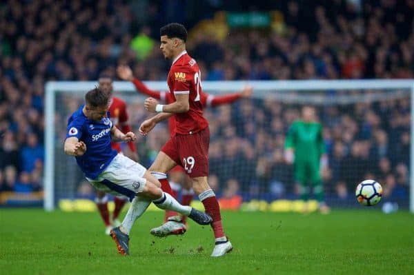 LIVERPOOL, ENGLAND - Saturday, April 7, 2018: Liverpool's Dominic Solanke is tackled by Everton's Morgan Schneiderlin during the FA Premier League match between Everton and Liverpool, the 231st Merseyside Derby, at Goodison Park. (Pic by David Rawcliffe/Propaganda)