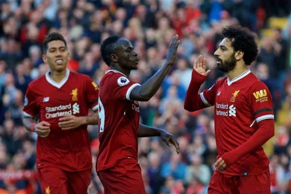 Liverpool's Mohamed Salah (right) celebrates scoring the second goal with team-mates Sadio Mane (centre) and Roberto Firmino (left) during the FA Premier League match between Liverpool FC and AFC Bournemouth at Anfield. (Pic by Laura Malkin/Propaganda)