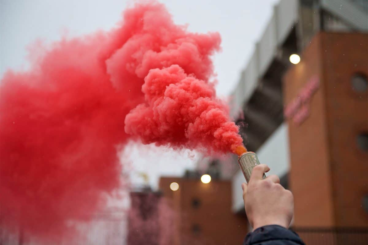 LIVERPOOL, ENGLAND - Tuesday, April 24, 2018: Liverpool supporters with a red smoke bomb before the UEFA Champions League Semi-Final 1st Leg match between Liverpool FC and AS Roma at Anfield. (Pic by David Rawcliffe/Propaganda)