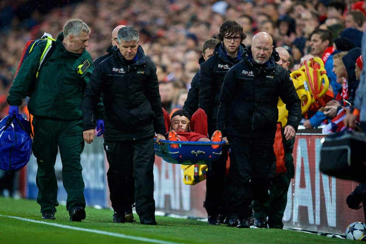 Liverpool's Alex Oxlade-Chamberlain is carried off injured during the UEFA Champions League Semi-Final 1st Leg match between Liverpool FC and AS Roma at Anfield. (Pic by David Rawcliffe/Propaganda)