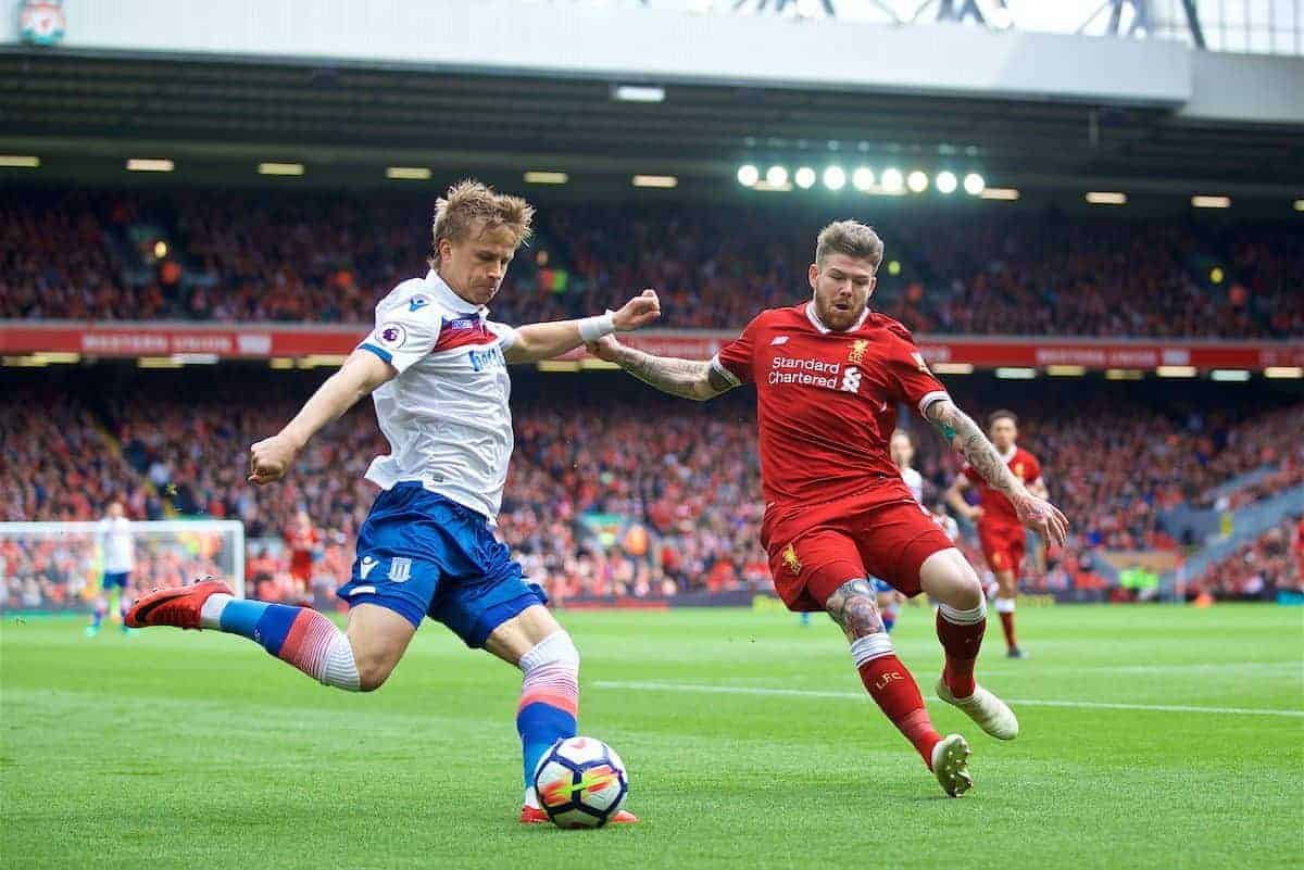 LIVERPOOL, ENGLAND - Saturday, April 28, 2018: Liverpool's Alberto Moreno and Stoke City's Phil Bardsley during the FA Premier League match between Liverpool FC and Stoke City FC at Anfield. (Pic by David Rawcliffe/Propaganda)