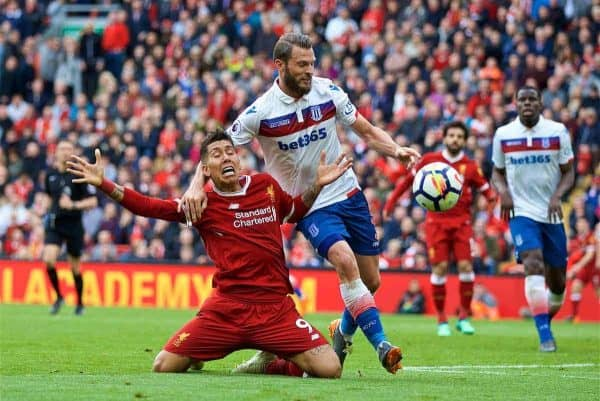 LIVERPOOL, ENGLAND - Saturday, April 28, 2018: Liverpool's Roberto Firmino is brought down by Stoke City's Erik Pieters but no penalty is awarded during the FA Premier League match between Liverpool FC and Stoke City FC at Anfield. (Pic by David Rawcliffe/Propaganda)