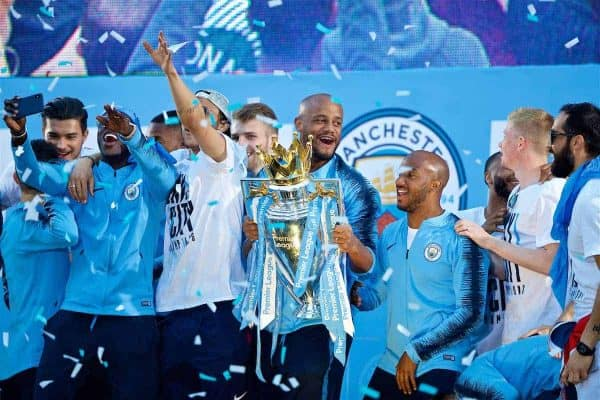 MANCHESTER, ENGLAND - Monday, May 14, 2018: Manchester City's captain Vincent Kompany celebrates with the trophy on stage after the parade through the city after winning the FA Premier League and the Football League Cup trophies. (Pic by David Rawcliffe/Propaganda)