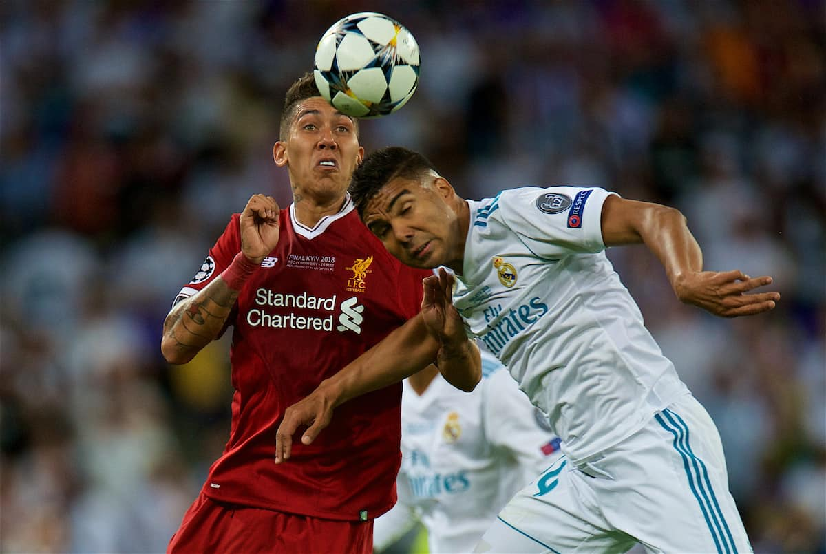 KIEV, UKRAINE - Saturday, May 26, 2018: Liverpool's Roberto Firmino and Real Madrid's Casemiro during the UEFA Champions League Final match between Real Madrid CF and Liverpool FC at the NSC Olimpiyskiy. (Pic by Peter Powell/Propaganda)