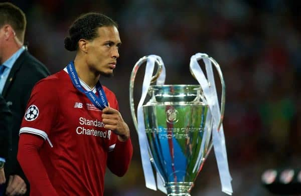 Liverpool's Virgil van Dijk walks past the trophy dejected with his runners-up medal during the UEFA Champions League Final match between Real Madrid CF and Liverpool FC at the NSC Olimpiyskiy. Real Madrid won 3-1. (Pic by Peter Powell/Propaganda)