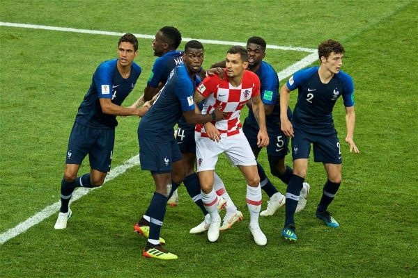 Croatia's Dejan Lovren is surrounded by France players during the FIFA World Cup Russia 2018 Final match between France and Croatia at the Luzhniki Stadium. (Pic by David Rawcliffe/Propaganda)
