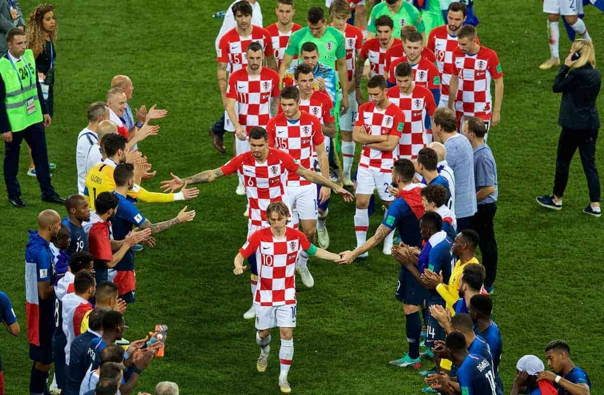 MOSCOW, RUSSIA - Sunday, July 15, 2018: Croatia's captain Luka Modri? and Dejan Lovren walk through a Guard of Honour from the France players after the FIFA World Cup Russia 2018 Final match between France and Croatia at the Luzhniki Stadium. France won 4-2. (Pic by David Rawcliffe/Propaganda)