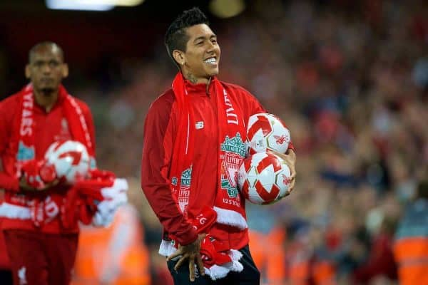 Liverpool's Roberto Firmino hands out balls and scarves top supporters after the preseason friendly match between Liverpool FC and Torino FC at Anfield. (Pic by David Rawcliffe/Propaganda)