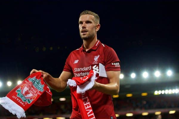 Liverpool's captain Jordan Henderson hands out balls and scarves top supporters after the preseason friendly match between Liverpool FC and Torino FC at Anfield. (Pic by David Rawcliffe/Propaganda)