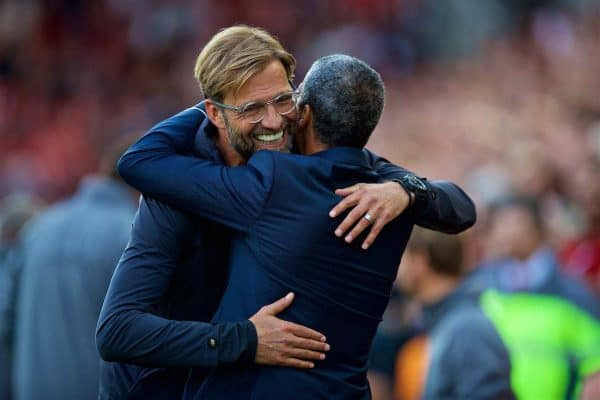 LIVERPOOL, ENGLAND - Saturday, August 25, 2018: Liverpool's manager Jürgen Klopp embraces Brighton & Hove Albion's manager Chris Hughton before the FA Premier League match between Liverpool FC and Brighton & Hove Albion FC at Anfield. (Pic by David Rawcliffe/Propaganda)
