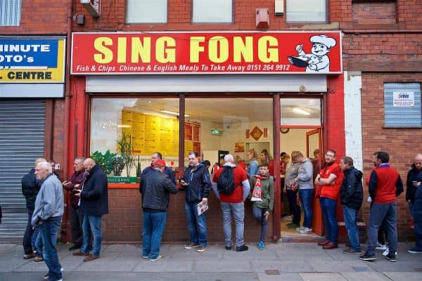 LIVERPOOL, ENGLAND - Tuesday, September 18, 2018: Supporters frequent Sing Fong, a famous Chinese chip shop outside Anfield, before the UEFA Champions League Group C match between Liverpool FC and Paris Saint-Germain. (Pic by David Rawcliffe/Propaganda)