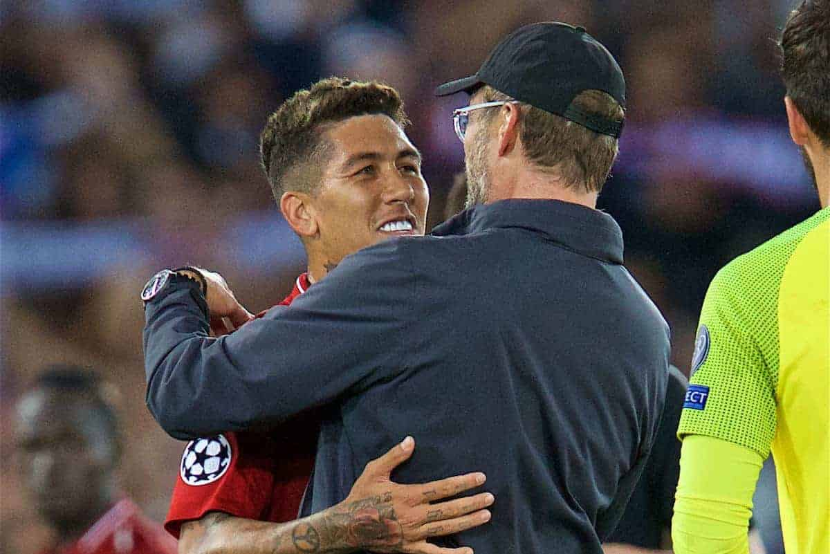 LIVERPOOL, ENGLAND - Tuesday, September 18, 2018: Liverpool's manager Jürgen Klopp (right) celebrates with Roberto Firmino after the UEFA Champions League Group C match between Liverpool FC and Paris Saint-Germain at Anfield. Liverpool won 3-2. (Pic by David Rawcliffe/Propaganda)