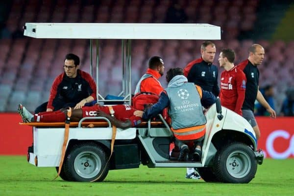 Liverpool's Naby Keita is carried off injured during the UEFA Champions League Group C match between S.S.C. Napoli and Liverpool FC at Stadio San Paolo. (Pic by David Rawcliffe/Propaganda)