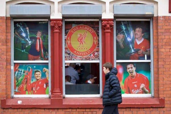 LIVERPOOL, ENGLAND - Sunday, October 7, 2018: A supporter walks past images of Liverpool legends in the window of the Albert Pub before the FA Premier League match between Liverpool FC and Manchester City FC at Anfield. (Pic by David Rawcliffe/Propaganda)