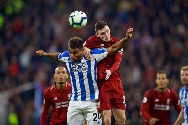 Liverpool's Andy Robertson (right) and Huddersfield Town's Steve Mounié during the FA Premier League match between Huddersfield Town FC and Liverpool FC at Kirklees Stadium. (Pic by David Rawcliffe/Propaganda)