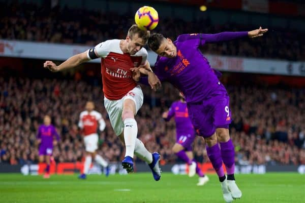 LONDON, ENGLAND - Saturday, November 3, 2018:Arsenal's Rob Holding (L) and Liverpool's Roberto Firmino (R) during the FA Premier League match between Arsenal FC and Liverpool FC at Emirates Stadium. (Pic by David Rawcliffe/Propaganda)
