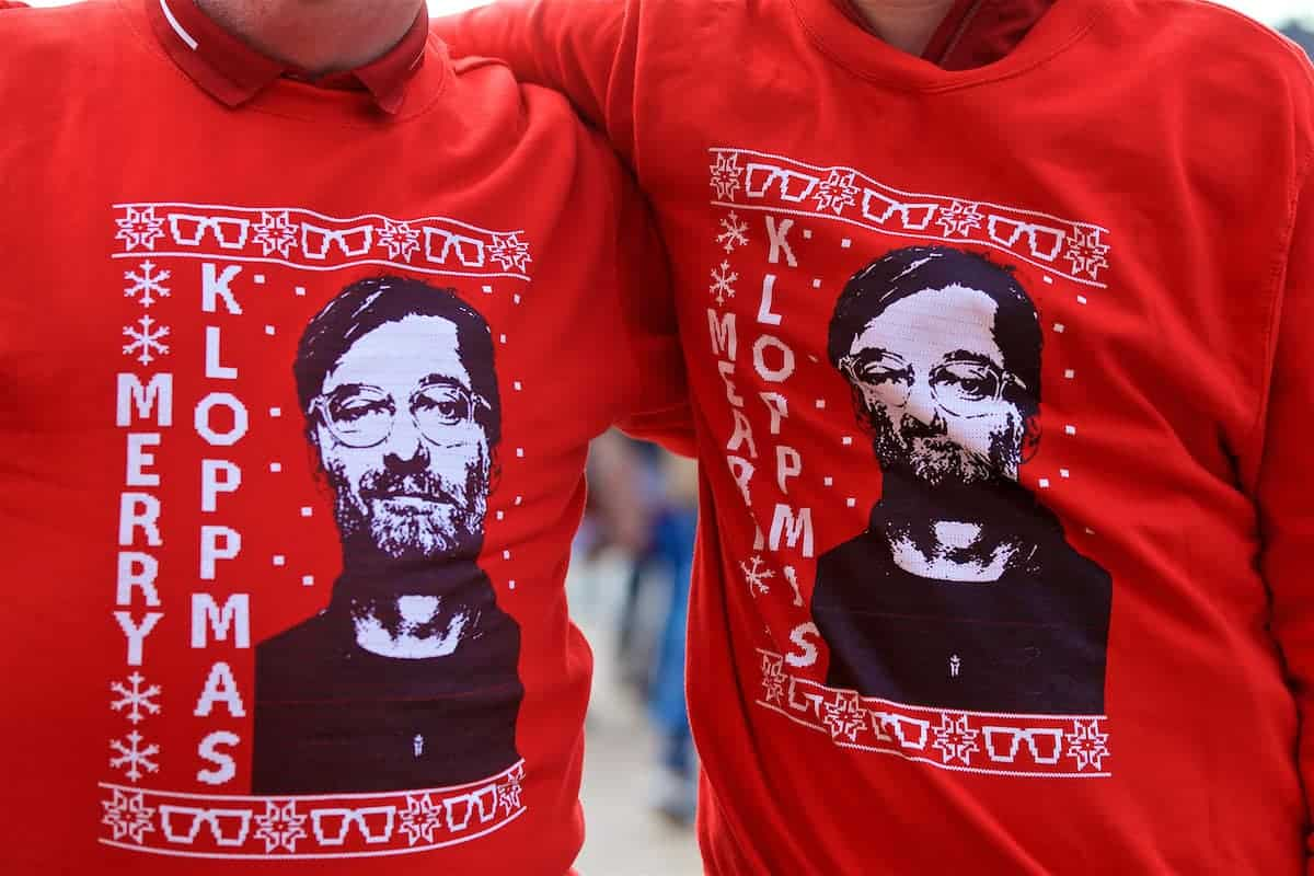 "LIVERPOOL, ENGLAND - Sunday, December 2, 2018: Two Liverpool supporters wearing Christmas jumpers featuring Jürgen Klopp ""Merry Kloppmas"" before the FA Premier League match between Liverpool FC and Everton FC at Anfield, the 232nd Merseyside Derby. (Pic by Paul Greenwood/Propaganda)"