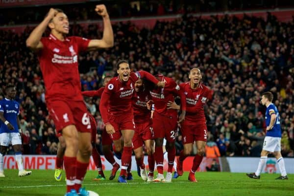 LIVERPOOL, ENGLAND - Sunday, December 2, 2018: Liverpool's Divock Origi (2nd from R) celebrates with team-mates Virgil van Dijk (L) and Fabio Henrique Tavares 'Fabinho' (R) after his winning goal deep into injury time during the FA Premier League match between Liverpool FC and Everton FC at Anfield, the 232nd Merseyside Derby. Liverpool won 1-0. (Pic by Paul Greenwood/Propaganda)